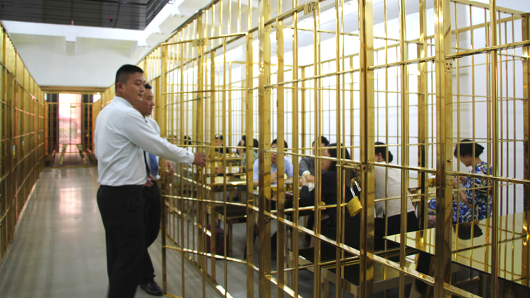 Eat prison lunch in a gilded gold cell