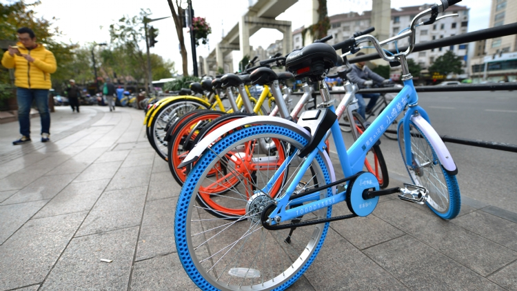 And another! Shanghai's latest bike-sharing service offers 0.1RMB rental
