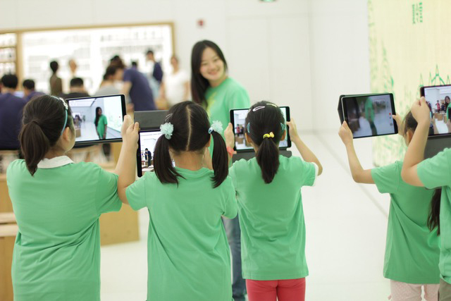 Children enjoying taking pictures with iPads