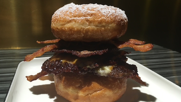 Feast on a doughnut and bacon burger at OH MY BURGER!