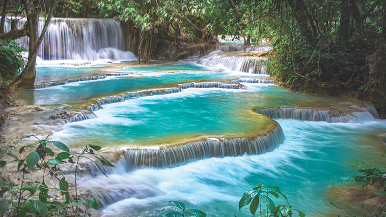 Escape Shanghai: waterfalls and hazy mountains in Luang Prabang, Laos