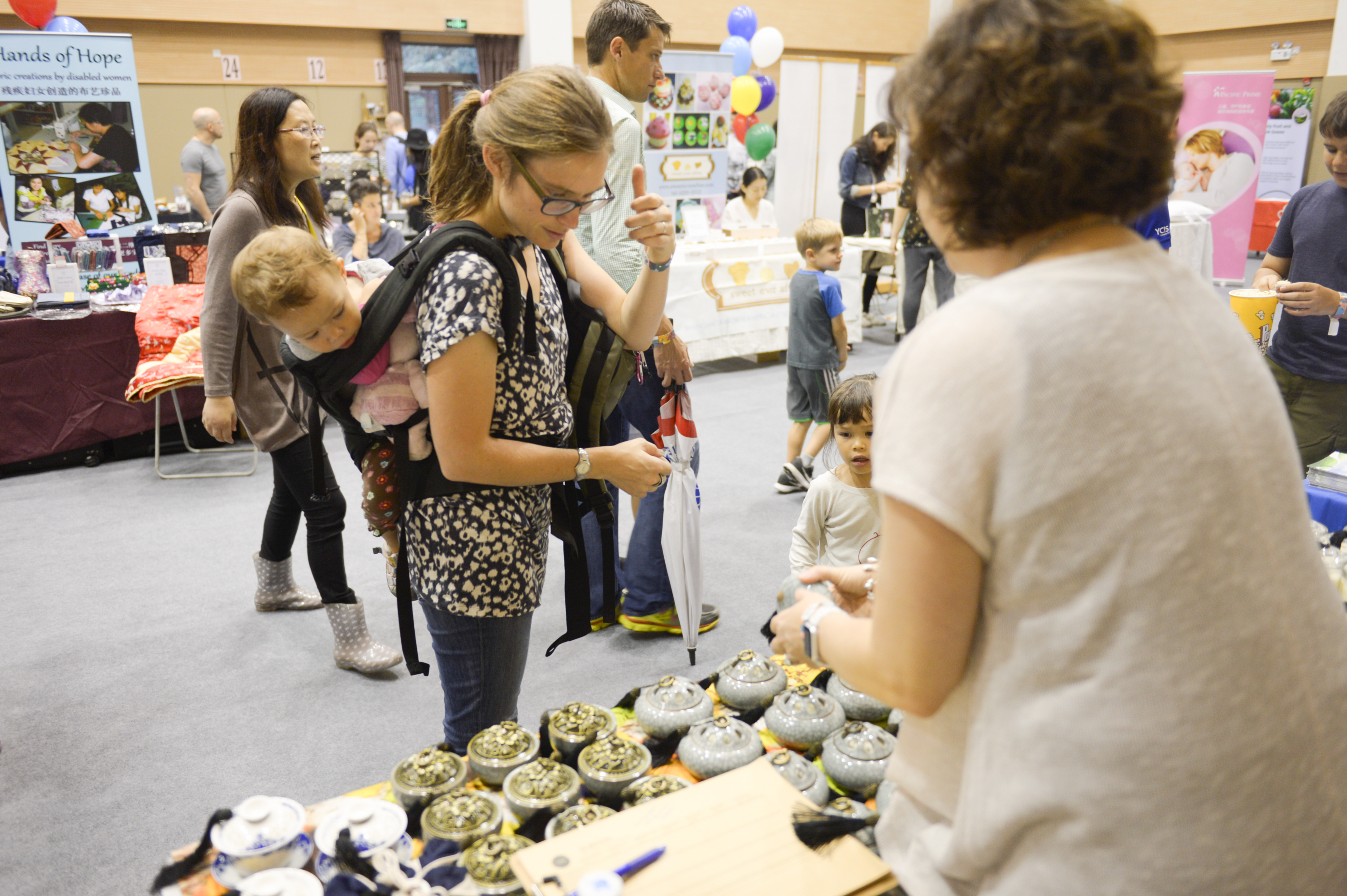 Families check out vendors and stalls at the event
