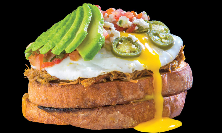 Open-faced carnitas breakfast sandwich